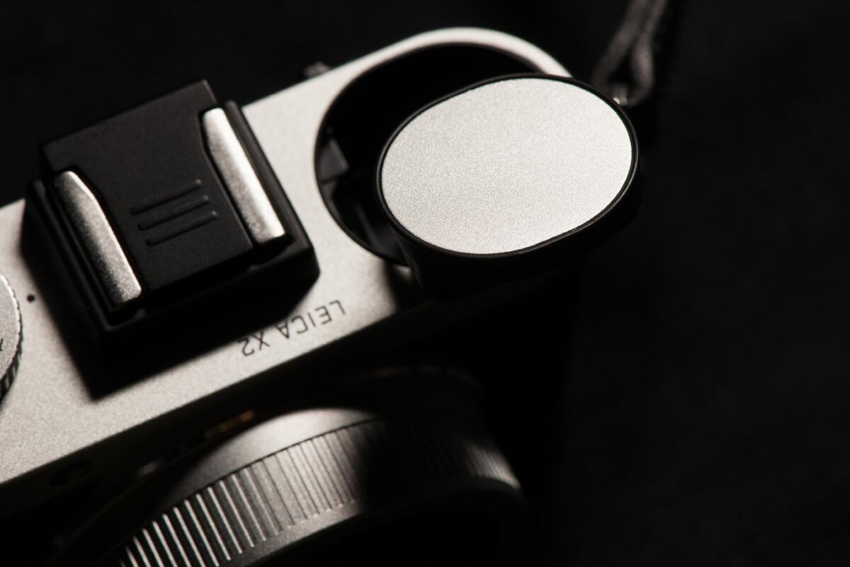 摄影 x2/左肩是机械式闪光灯,样子很Q指数不大不可跳闪